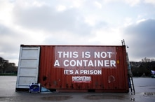 FILE - A shipping container bearing the slogan