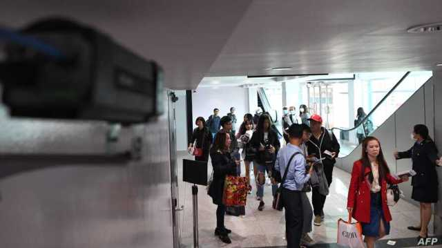 A thermal scanner monitors arriving passengers at Phnom Penh international airport in Cambodia, Jan. 22, 2020.