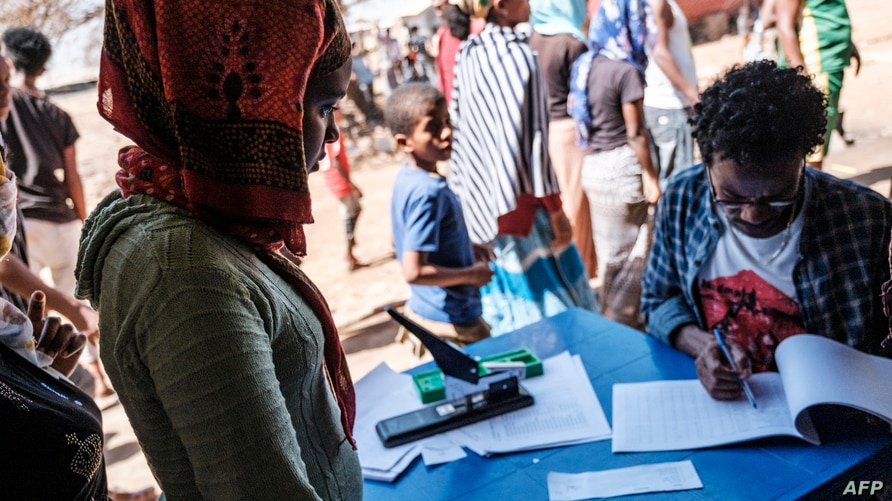 An Eritrean refugee woman is registered at Mai Aini Refugee camp, in Ethiopia, Jan. 30, 2021.