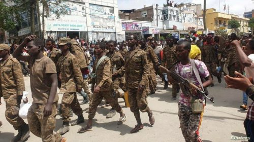 Ethiopian government soldiers and prisoners of war in military uniforms walk through the streets of Mekelle, the capital of…