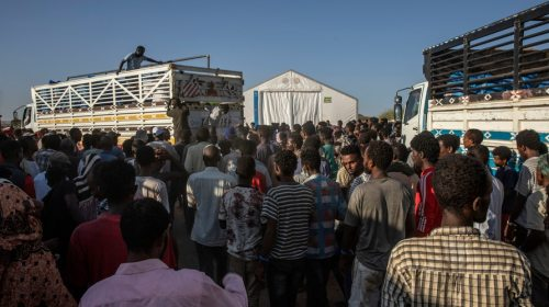 Tigray refugees who fled the conflict in Ethiopia's Tigray region, wait to receive aid at Umm Rakouba refugee camp in Qadarif,…