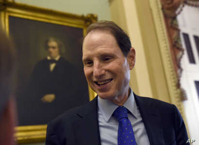 Sen. Ron Wyden, D-Ore. talks with a reporter before the start of a meeting with Senate Democrats on Capitol Hill in Washington, May 22, 2015.