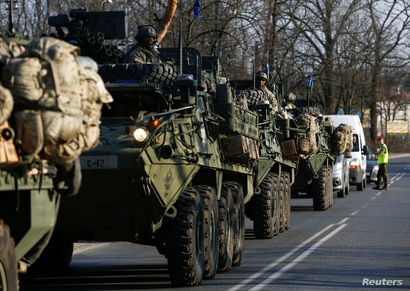 FILE - A convoy of U.S. troops, a part of NATOs reinforcement of its eastern flank, drive from Germany to Orzysz in northeast Poland, March 28, 2017.