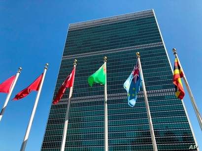 FILE - Flags fly outside the United Nations headquarters in New York.