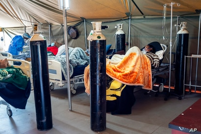 FILE - COVID-19 patients are being treated with oxygen at a hospital in Pretoria, South Africa, July 10, 2020.