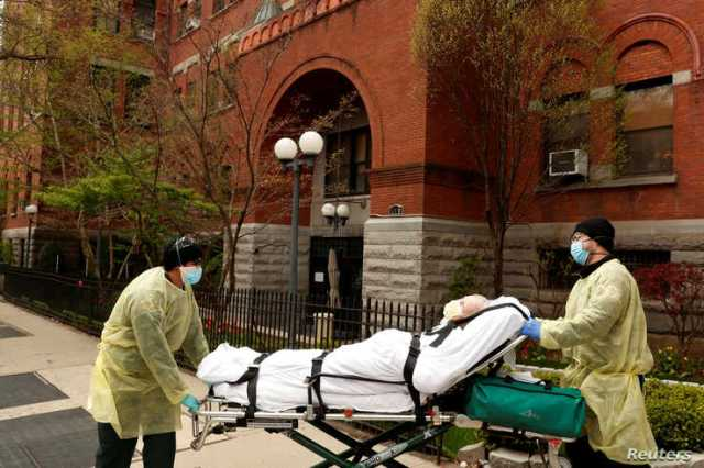 Emergency Medical Technicians (EMTs) wheel a man out of the Cobble Hill Health Center nursing home during an ongoing outbreak of the coronavirus disease (COVID-19) in the Brooklyn borough of New York, April 17, 2020.