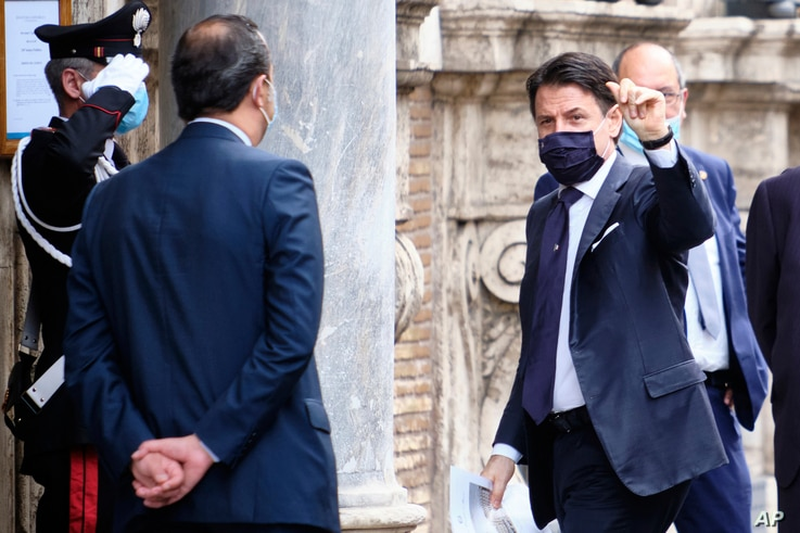 Prime minister Giuseppe Conte wears a face mask to prevent the spread of COVID-19 as he arrives to address parliament on the next European Council meeting, in Rome, June 17, 2020.
