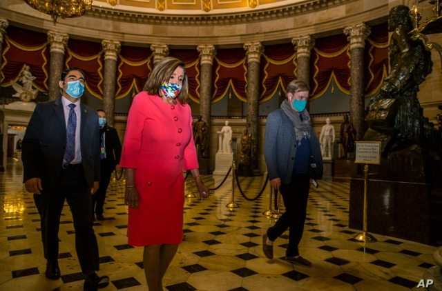House Speaker Nancy Pelosi walks towards the House Chamber at the Capitol, July 20, 2020, in Washington.