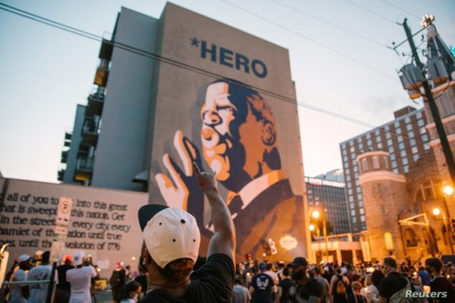 Mourners of the late Rep. John Lewis, a pioneer of the civil rights movement and long-time member of the U.S. House of Representatives, hold a vigil in his memory in Atlanta, Georgia, July 19, 2020.