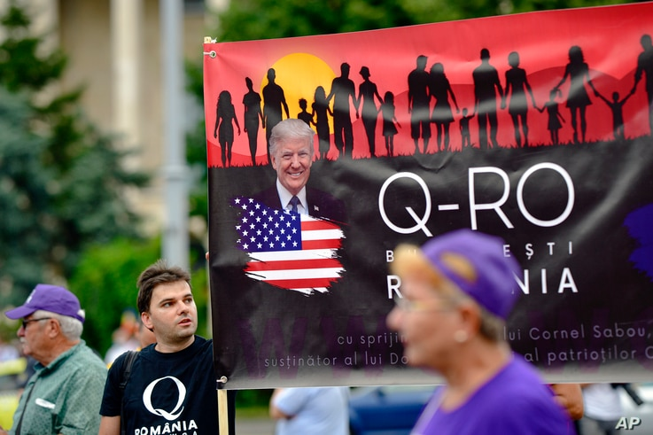 Romanian supporters of QAnon take part in a rally against the government's measures to prevent the spread of COVID-19.