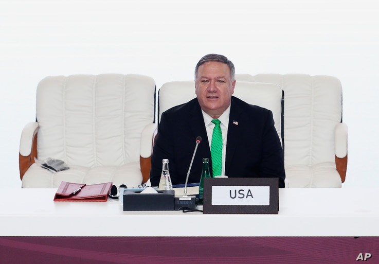 U.S. Secretary of State Mike Pompeo talks at the opening session of peace talks between the Afghan government and the Taliban, in Doha, Qatar, Sept. 12, 2020.