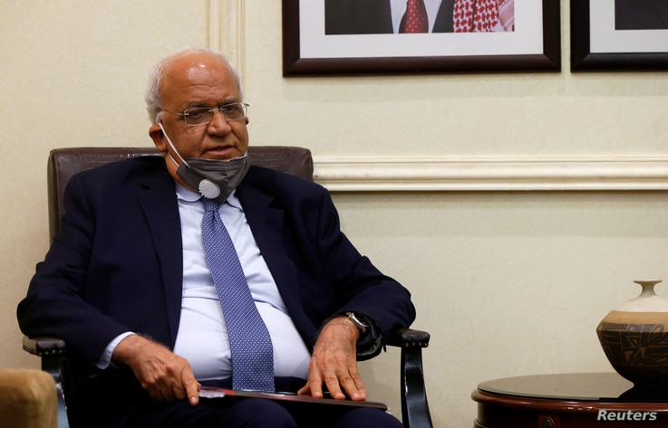 FILE PHOTO: Palestinian Chief Negotiator Saeb Erekat meets with Jordanian Foreign Minister Ayman Safadi (not pictured) in Amman