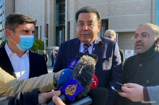 Yasin Aktay, an adviser to Turkish President Tayyip Erdogan, and Egyptian politician Ayman Nour talk to media after attending a…