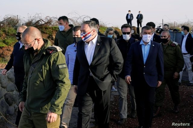 U.S. Secretary of State Mike Pompeo is accompanied by Israeli Foreign Minister Gabi Ashkenazi as they arrive for a security briefing on Mount Bental in the Israeli-occupied Golan Heights, Nov. 19, 2020.
