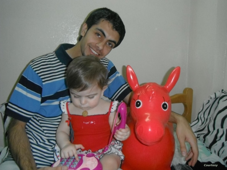 Maimouna al-Ammar's brother, Iqbal, is seen with her one-year-old Imar, in Damascus in 2012, before his arrest by Syrian government security. Al-Ammar has been looking for her missing brothers for eight years. (Courtesy: Maimouna al-Ammar)
