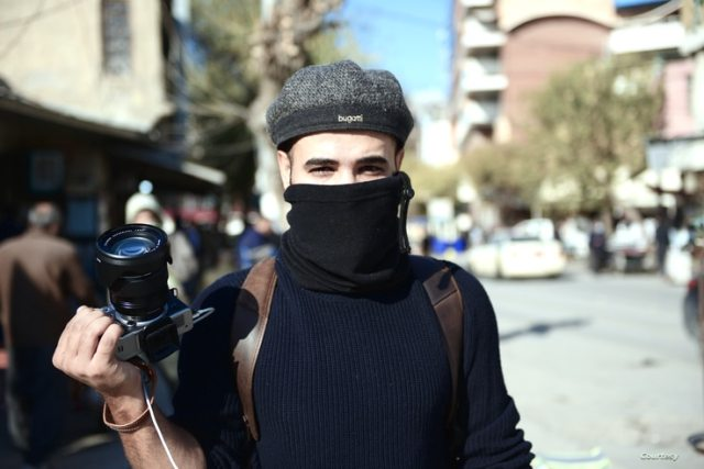Journalist Rebaz Majeed, pictured covering anti-government protests in the Iraqi Kurdistan city, Sulaymaniyah on Dec. 3, 2020. (Courtesy, Fareq Halabjayi)