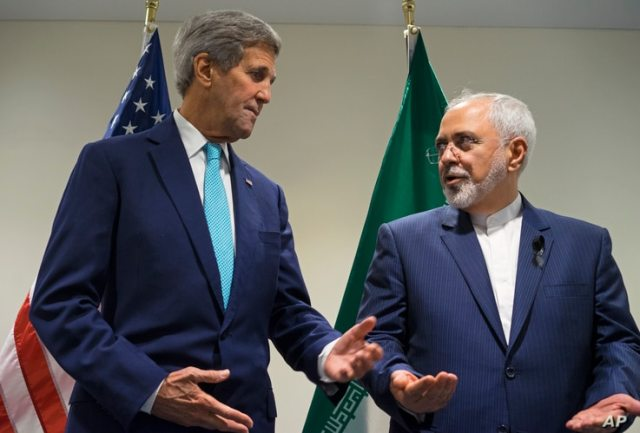 FILE - In this Saturday, Sept. 26, 2015 file photo, US Secretary of State John Kerry, left, meets with Iranian Foreign Minister…