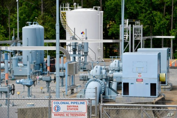 A Colonial Pipeline station is seen, Tuesday, May 11, 2021, in Smyrna, Ga., near Atlanta. Colonial Pipeline, which delivers…