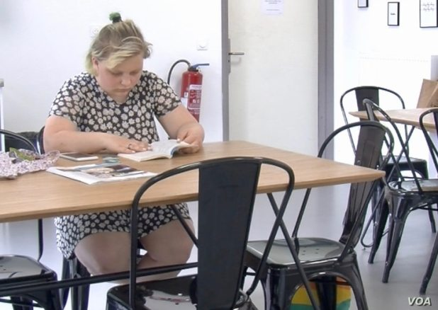 Katazyna Mac studies for final exams at her-student housing outside Paris