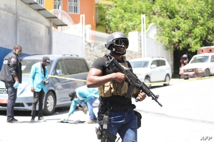 Members of the Haitian police and forensics look for evidence outside of the presidential residence on July 7, 2021 in Port-au…