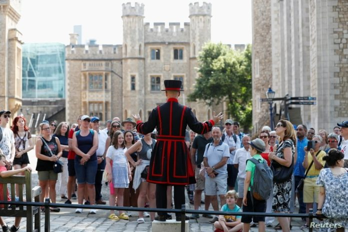"""Barney Chandler, a Yeoman warder, talks to the group as he leads the first. """"beefeater"""" Visiting the Tower of London at 16..."""