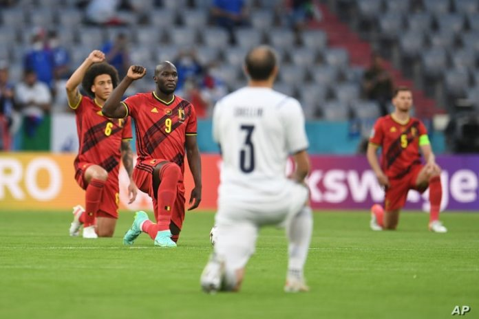 Players kneel before the quarterfinal match of the Euro 2020 Football Championship between Belgium and Italy at the Allianz Arena.