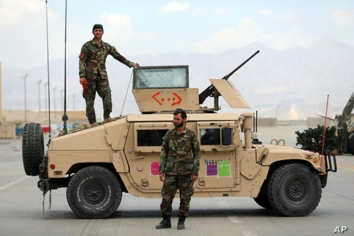 Afghan army personnel stand guard after being released by US forces from Bagram airport in Parwan province, north of Kabul.