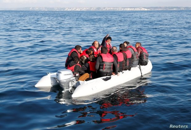 Migrants who launched from the coast of northern France cross the English Channel in an inflatable boat near Dover, Britain,…