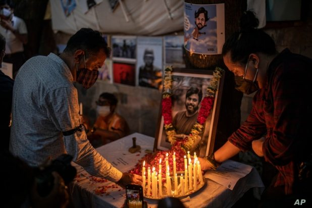 Journalists light candles and pay tribute to Reuters photographer Danish Siddiqui in New Delhi, India, Saturday, July 17, 2021…