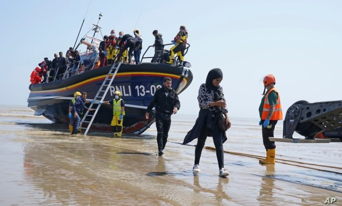 A group of people thought to be migrants from France came aboard a local lifeboat in Dungeness, south of...