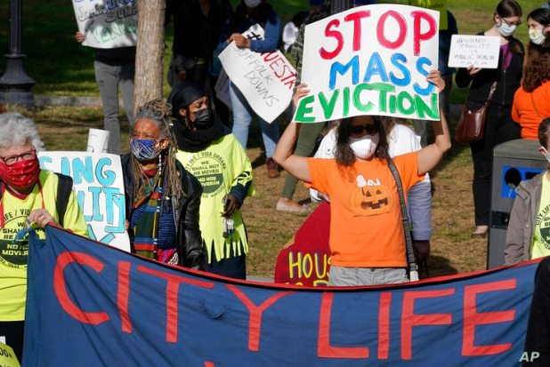 FILE - In this Oct. 11, 2020 file photo, protesters display placards while calling for support for tenants and homeowners at…