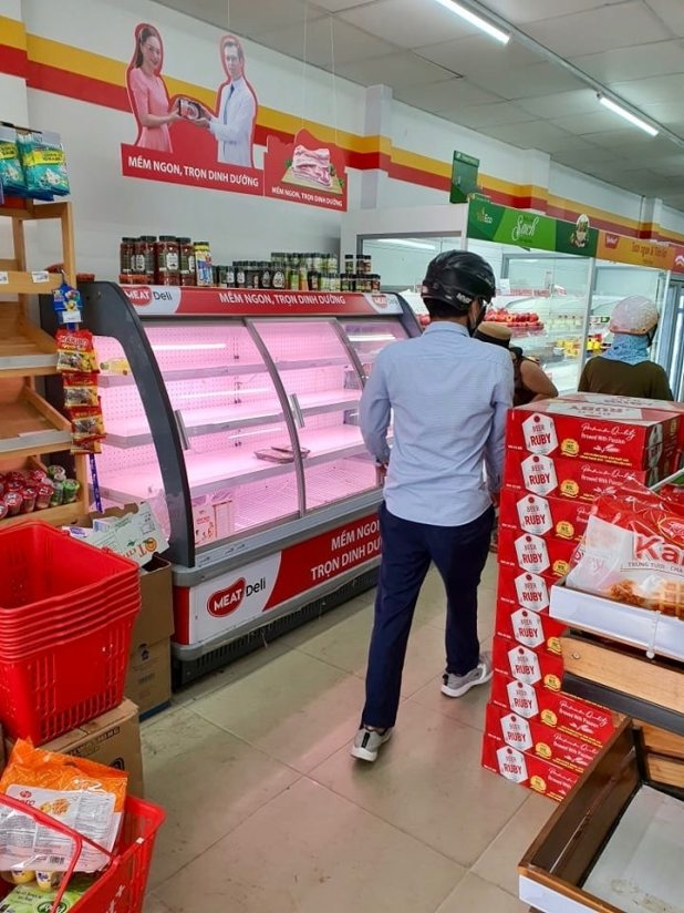 Shelves at a local minimart are nearly empty after authorities announce a lockdown in Da Nang, Vietnam. August 2021.