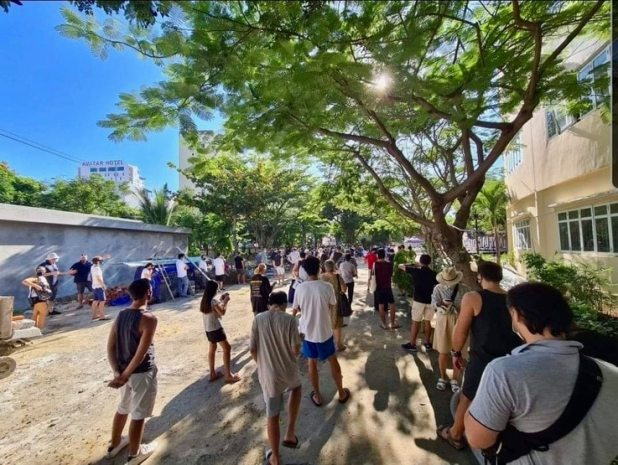 People line up to get tested for COVID-19 in a Da Nang neighborhood in September 2021.
