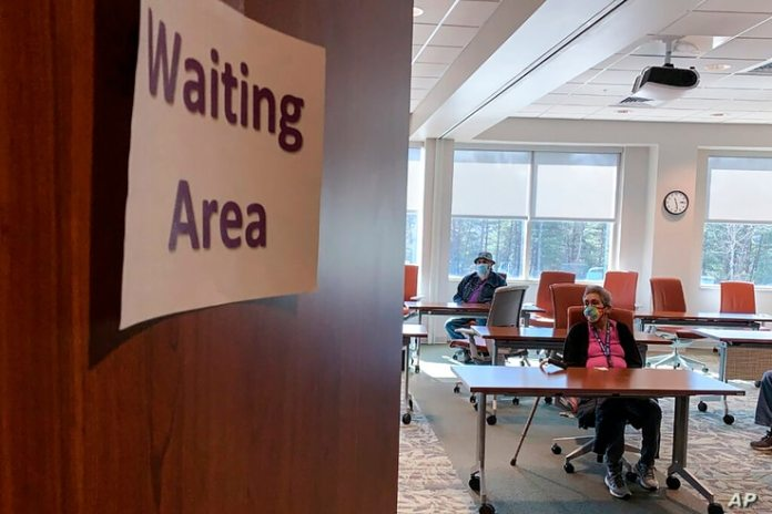 File-In a file photo on Thursday, January 28, 2021, a woman waits for 15 minutes at the Cherokee Indian Hospital in Cherokee, North Carolina...