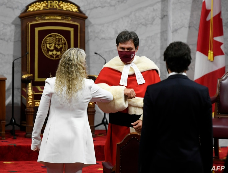 Canada's Governor General Julie Payette (L) greets Supreme Court of Canada Chief Justice Richard Wagner as she arrives with