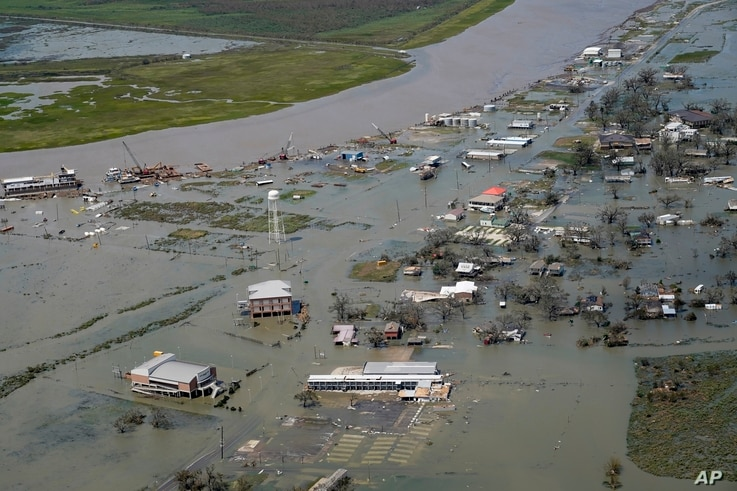 Buildings and homes are flooded in the aftermath of Hurricane Laura Thursday, Aug. 27, 2020, in Cameron, La. (AP Photo/David J…