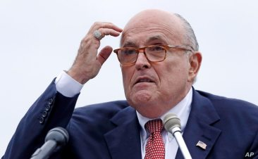 FILE - In this Aug. 1, 2018 file photo, Rudy Giuliani, an attorney for President Donald Trump, addresses a gathering during a…