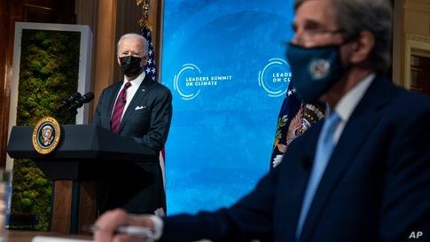 President Joe Biden and Special Presidential Envoy for Climate John Kerry listen during the virtual Leaders Summit on Climate,…