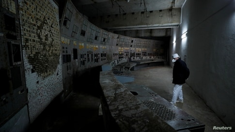An employee walks at a control centre of the damaged fourth reactor at the Chernobyl Nuclear Power Plant