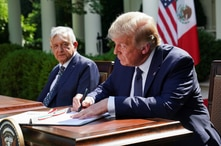 U.S. President Donald Trump signs a joint declaration with Mexico's President Andres Manuel Lopez Obrador as they sit side by…