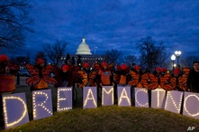 Demonstrators rally in support of Deferred Action for Childhood Arrivals (DACA) outside the Capitol, Sunday, Jan. 21, 2018, in…