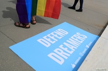 FILE PHOTO: A sign in support of DACA Dreamers lies at the steps of the U.S. Supreme Court after the court declined to hear a…