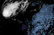 This image obtained from the National Oceanic and Atmospheric Administration (NOAA) shows a satellite Star GOES-West Geocolor…