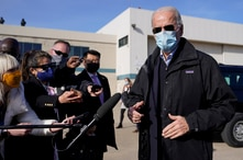 President-elect Joe Biden speaks to members of the media before boarding a plane at New Castle Airport in New Castle, Del.,…