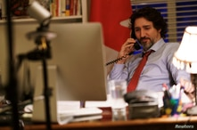 FILE PHOTO: Canada's Prime Minister Justin Trudeau speaks on the phone with U.S. President Joe Biden in Ottawa