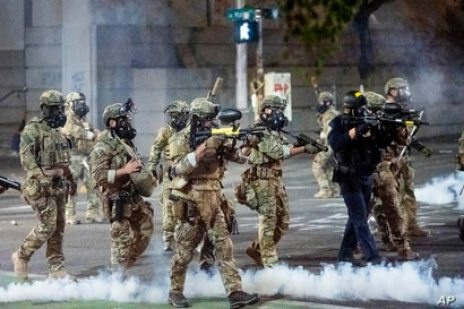 Federal agents use crowd control munitions to disperse Black Lives Matter protesters at the Mark O. Hatfield United States…