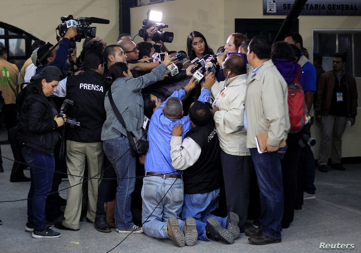 Reporters interview US Diplomat Heide B Fulton after a news conference where the Supreme Electoral Tribunal announced that will…