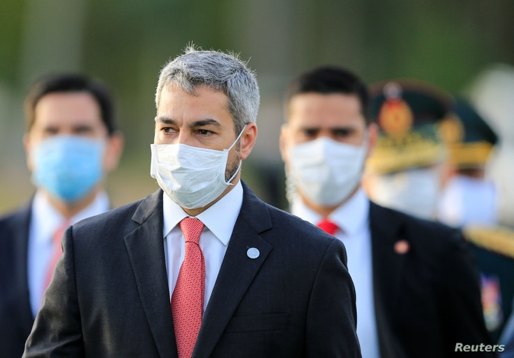 President Mario Abdo Benitez wears a face mask as he arrives for a ceremony in tribute to veterans of the 1932-1935 Chaco War…