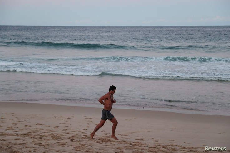 A lone jogger exercises at Coogee Beach in Sydney