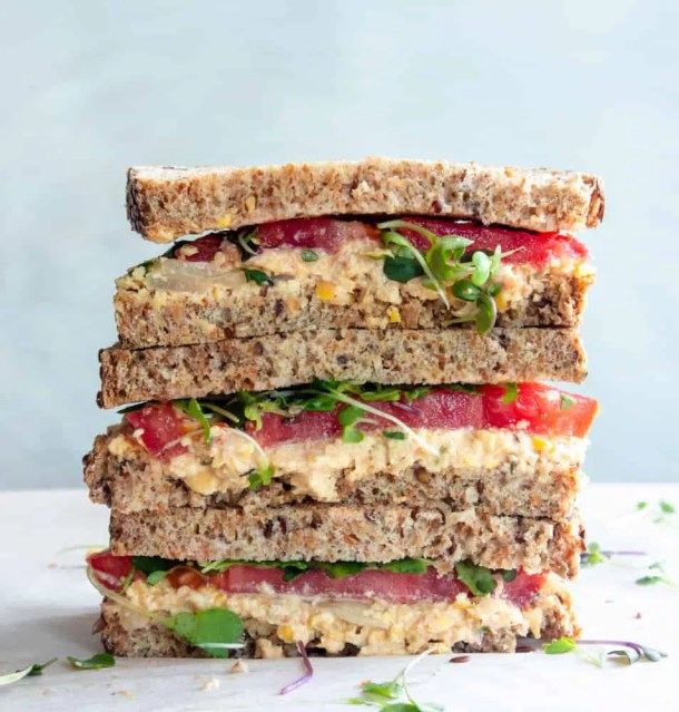 stacked vegan chickpea salad sandwich, chickpea salad sandwich recipe, chickpea avocado sandwich